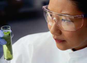 Scientist inspecting a vial